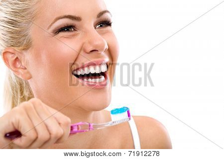 Laughing young woman with healthy teeth holding a tooth-brush poster