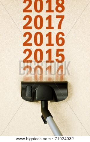 Vacuum Cleaner Sweeping Year Number 2014 From Carpet
