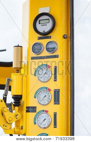Meters or gauge in crane cabin for measure