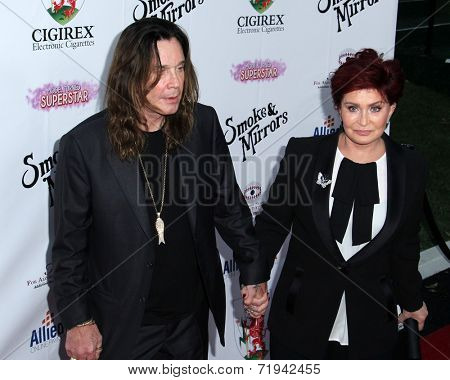 LOS ANGELES - SEP 13:  Ozzy Osbourne, Sharon Osbourne at the 2014 Brent Shapiro Foundation Summer Spectacular at Private Residence on September 13, 2014 in Beverly Hills, CA