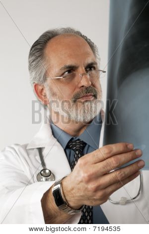 Doctor Looking At X-ray. Isolated