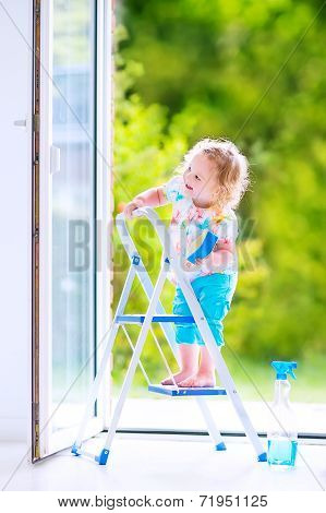 Adorable Little Girl Washing A Window