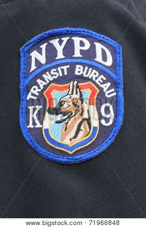 Close up of shoulder  patch of NYPD Transit Bureau K-9 Unit