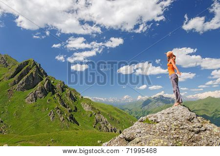 Young woman standing on a rock