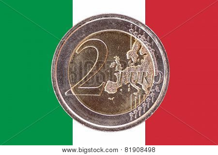 Common Face Of Two Euro Coin On Flag Of Italy