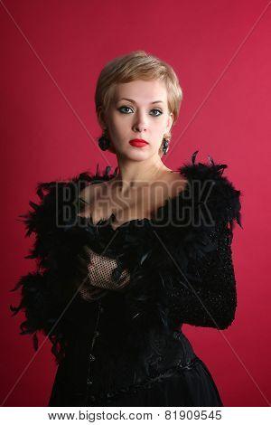 The blonde in a black boa