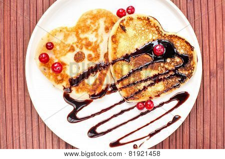 Heart Shaped Pancakes With Chocolate Sauce And Cranberries.