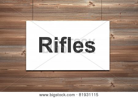 White Canvas Hanging On Natural Brown Wooden Wall Rifles