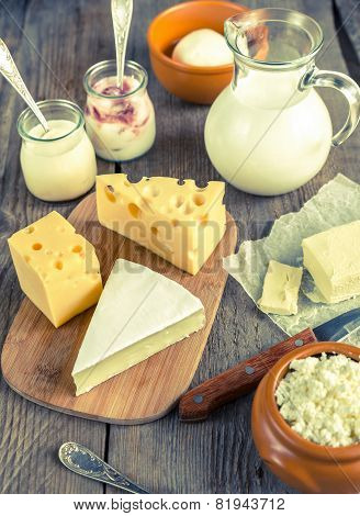 Various Types Of Dairy Products On The Wooden Background poster