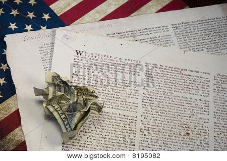 US Constitution with Crumpled Dollar