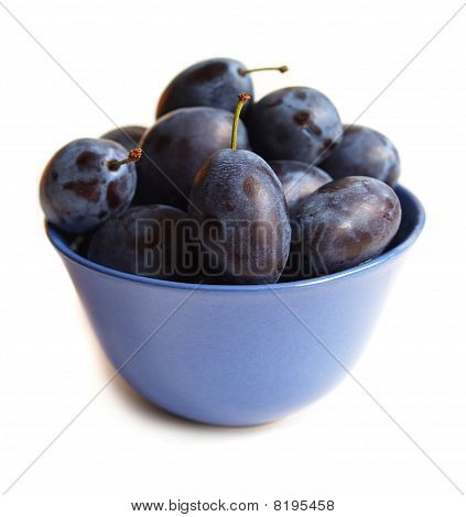 Plums On Blue Plate
