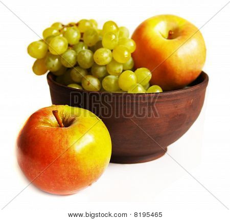 Grapes And Apples In The Clay Plate