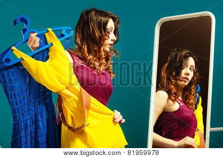Woman Trying Dress Shopping For Clothing.