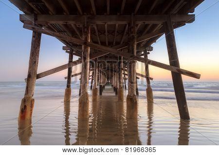 Under newport Beach pier after sunset