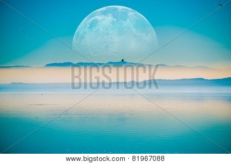 Beyond the Horizon. Fantasy Landscape with Large Moon on the Horizontal Mountains and the Calm Sea. poster