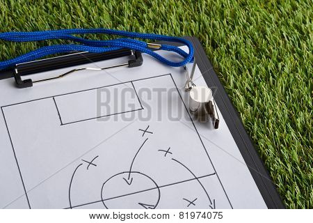 Whistle And Soccer Tactic Diagram On Paper