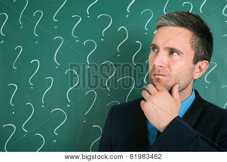 Portrait Of Contemplated Businessman