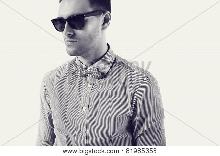 Young man hipster  with bow tie sunglasses confident certained, serious look. Black and white