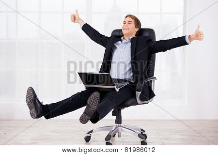 Business man reposing on headchair