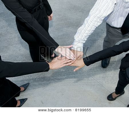 Business Team With Hands In The Huddle
