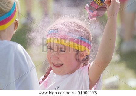 Happy Kid Squirting Pink Color Powder Over The Head