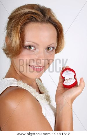 Woman With Wedding Rings In Red Box