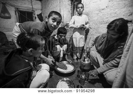 KATHMANDU, NEPAL - CIRCA DEC, 2013: Unknown children during dinner at Jagadguru School. School established at 2013, to let new generation learn Sanskrit and preserve Hindu culture.