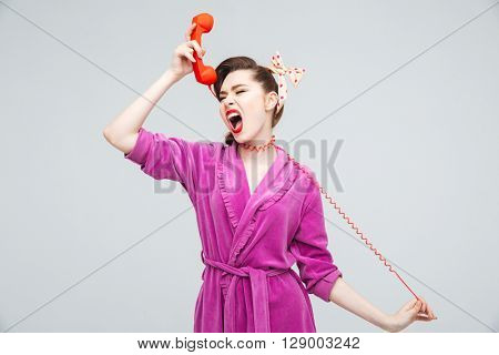 Crazy young housewife strangling herself with telephone wire and screaming