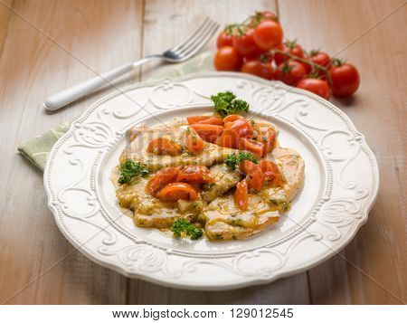 escalope with tomatoes, selective focus