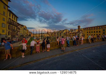 FLORENCE, ITALY - JUNE 12, 2015: Turists taking photos of Old Bridge or Ponte Vecchio in Florence, nice view