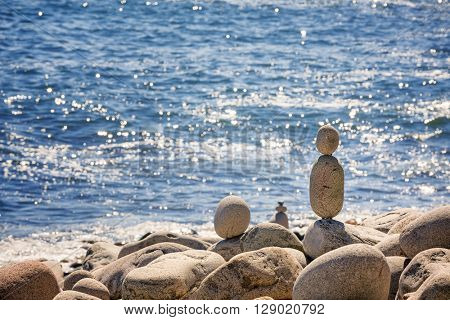 Stone stacks on Boulder Beach, Acadia National Park, Maine, USA. Space for your text.