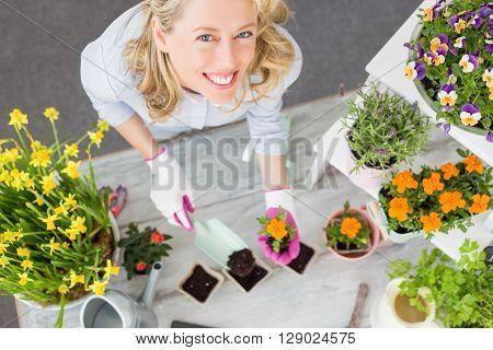 Happy woman doing gardening in studio setup