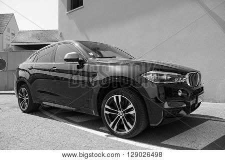 Saverne, Bas-Rhin, France -May 7, 2016: Black BMW X6 parked on the side of the street in the city of Saverne.