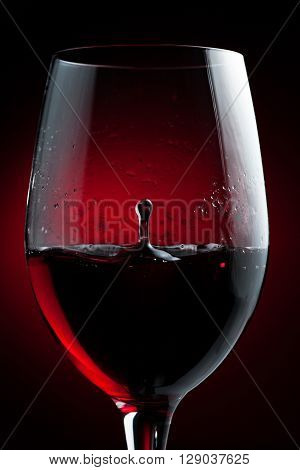 Red Wine Drop Splashing in a Glass ** Note: Visible grain at 100%, best at smaller sizes