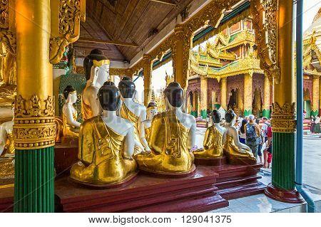 Yangon Myanmar - January 9 2012: Buddha satues in the Swedagon Pagoda.