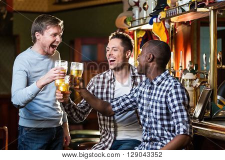Expression man with a beer indoors