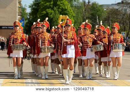Orel Russia - May 9 2016: Celebration of 71th anniversary of the Victory Day (WWII). Girls in red hussar uniform and short skirts marching horizontal