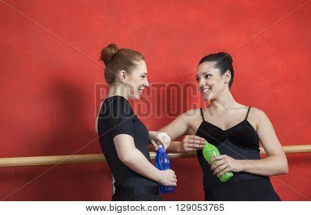 Friends Holding Water Bottles In Ballet Studio