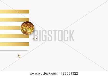 Elegant background. Gold stripe pattern polka and gold clip. Flat lay. Workspace with stationery. Mock-up background.