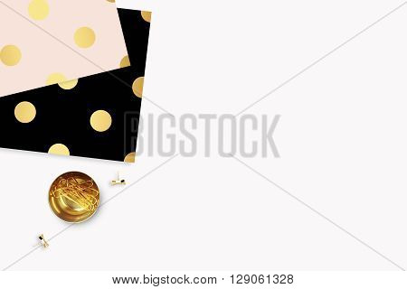 Elegant background. Pattern gold polka dots, and gold clip. Flat lay. Workspace with stationery. Mock-up background.