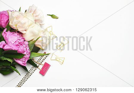 Flat lay. Mock-up background. Peonies. Pencil, gold items.