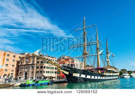 VENICE, ITALY - 17 OCTOBER 2015: The Palinuro, a historic Italian navy training barquentine, moored in Venice Italy in the Giudecca Canal. October 17 2015.