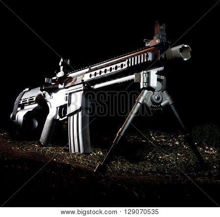 Modern sporting rifle in a pistol on a dark background