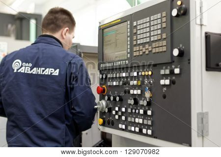"""ST. PETERSBURG, RUSSIA - APRIL 18, 2016: Man working in the Center of Fine Mechanics at JSC """"Avangard"""". It is Russia's leading company in radio electronics and microsystems engineering"""