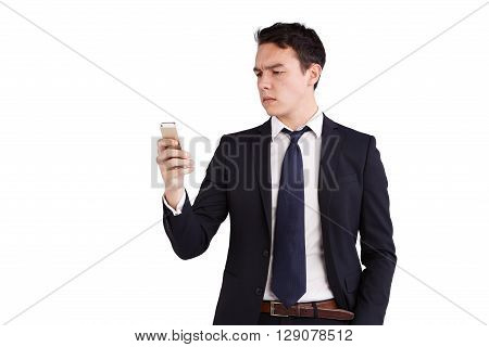 Young Caucasian Business Man Looking At Mobile Phone