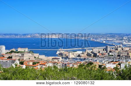 aerial view of Marseille, France, with the Fort Saint-Nicolas and the Old Port in the foreground