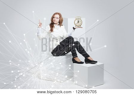 Attractive businesswoman showing clock