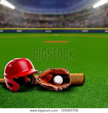 Baseball stadium full of fans in the stands with baseball helmet bat glove and ball on the field. Deliberate focus on equipment and foreground with shallow depth of field on background. Floodlights flare for effect and copy space.