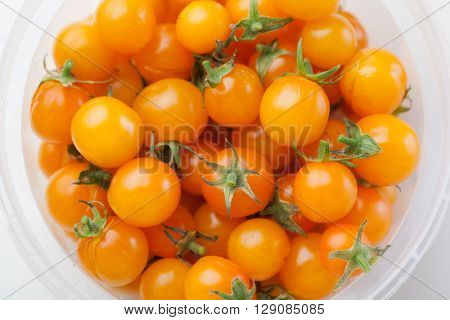 yellow cherry tomatoes in the container