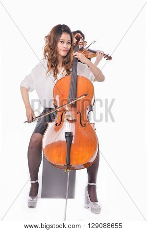 Two young woman is playing the violin-white background